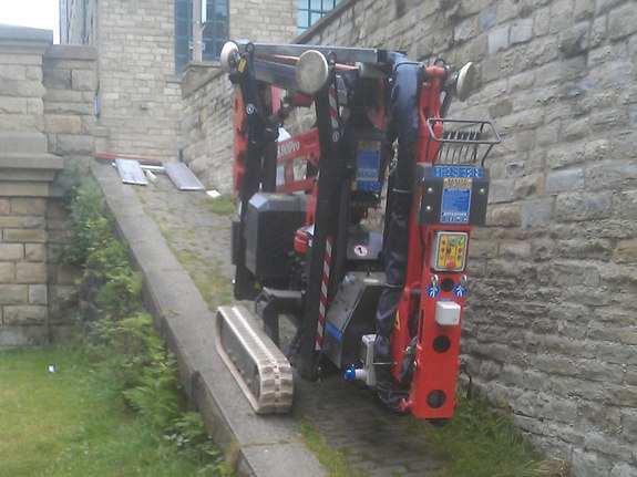 Sophie tracked spiderlift cherrypicker from High Reaching Solutions climbing towpath ramp in Halifax