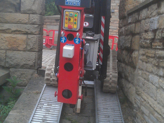 Sophie tracked spiderlift cherrypicker from High Reaching Solutions going through narrow gap on bridge in Halifax