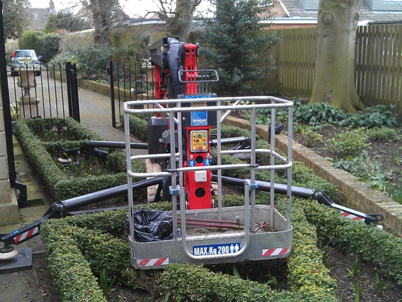 Sophie tracked spiderlift cherrypicker from High Reaching Solutions setting up in restrictive space for building maintenance in York