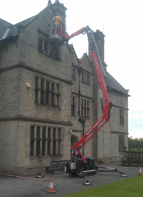 Sophie tracked spiderlift cherrypicker from High Reaching Solutions for maintenance on historic building near Kirkbymoorside Yorkshire