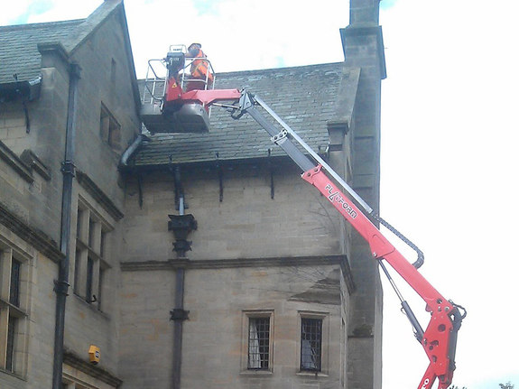 Sophie tracked spiderlift cherrypicker from High Reaching Solutions for roof maintenance on historic building near Kirkbymoorside Yorkshire
